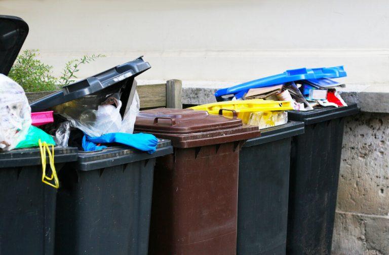 row of rubbish bins